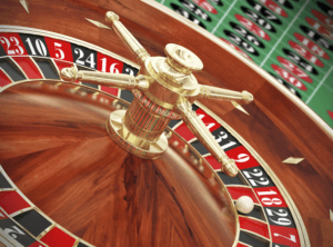 Roulette wheel with betting table behind it