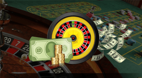 A Roulette Wheel with cash and coins beside it and a photo of a roulette wheel and table behind it