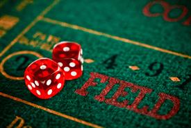 Craps table showing FIELD text with 2 red dices on top of the table
